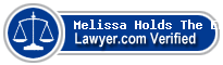 Melissa R. Holds The Enemy  Lawyer Badge